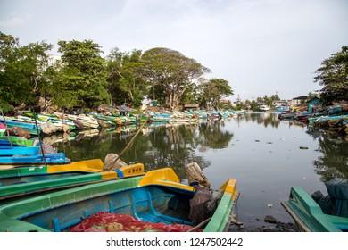 Negombo, Sri Lanka - July 24, 2018: Many colorful boats at the shore of Negombo Lagoon