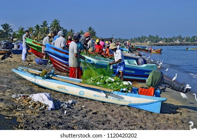 Negombo, Sri Lanka, March 27, 2018 - Fishermen unloading their fishing nets on the beach beside Negombo Fish Market.