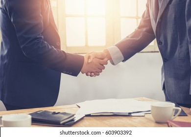 Negotiating business, businessmen handshake, happy with work,      Handshake Gesturing People Connection Deal Concept