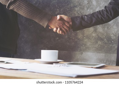 Negotiating business,Image of businessman Handshaking,happy with work, finishing up a meeting,Handshake Gesturing People Connection Deal Concept