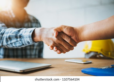 Negotiating business,Image of businessmen Handshaking,happy with work,Handshake Gesturing People Connection Deal Concept.