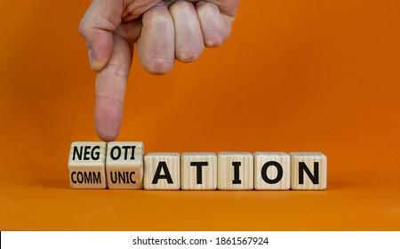 Negotiation and communication. Hand turns cubes and changes the word 'communication' to 'negotiation'. Beautiful orange background. Business, negotiation and communication concept. Copy space.