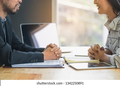 Negotiation of two statesman with clasped hands in office. Two men's hand on a desk with contract . Negotiating business concept.