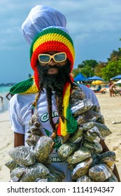 Negril, Jamaica - July 13 2014: Jamaican Rastafarian man selling herbs on the beach in Negril.