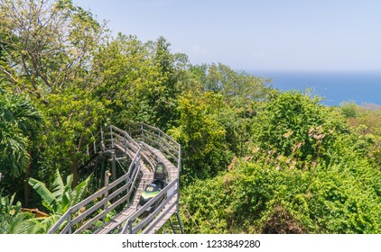 "Negril/Jamaica - July 2018: View of Jamaican Bobsled track at attraction in magic mountain, Ocho Rios, Negril, Jamaica, Caribbean. (""Bob Sleigh"")"