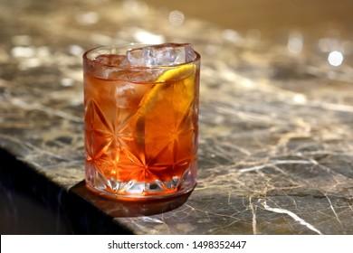 Negroni, classic italian drink with orange