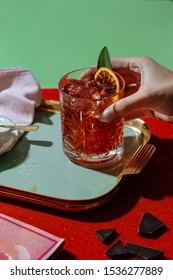 Negroni cocktail, an aperitif cocktail with a typical light red color, based on vermouth, bitters and gin. It is an officially recognized cocktail and one of the most famous