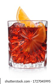 Negroni Cocktail in crystal glass with ice cubes and orange slice on white background
