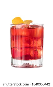 Negroni cocktail decorated with orange slice on the white background
