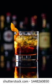 Negroni Cocktail with Orange Twist and Pin, on Dark Background. Beverage Photography. classic cocktail negroni blur bar