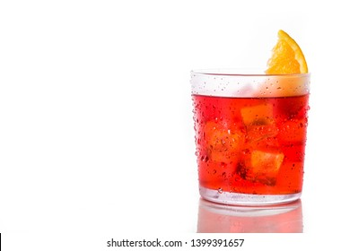 Negroni cocktail with piece of orange in glass isolated on white background. Copyspace