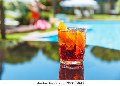 Negroni cocktail at the resort bar or suite patio. Luxury resort, vacation, room service concept. Horizontal