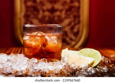 Negroni in  the eastern interior with ice, orange and lime on the background. close up. space.