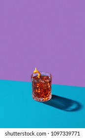 Negroni IBA cocktail, with gin, bitter, vermut, in pop contemporary style, colorful, dark background.
