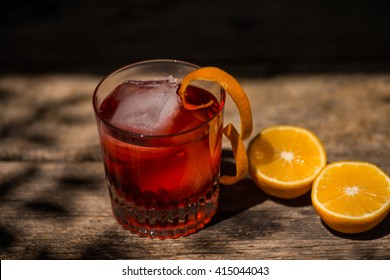 Negroni on a wooden board, black background