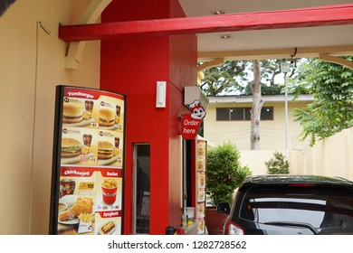 Negros Oriental, Philippines; January 12, 2019: The drive through window of a Jollibee branch in Dumaguete City, where a customer's orders are taken in.