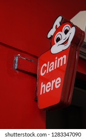 "Negros Oriental, Philippines; January 12, 2019: A sign at the ""drive through"" area of a Jollibee branch in Dumaguete City indicates that the next window is for claiming food orders."