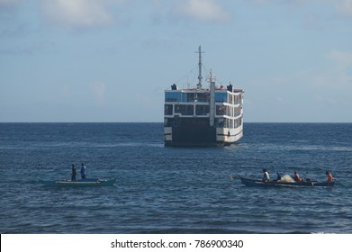 Negros Oriental, Philippines; January 4, 2017: A passenger ferry and two fishing boats traverse the waters between Dumaguete City and Siquijor Island.
