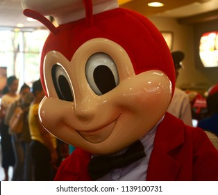 Negros Oriental, Philippines; June 23, 2018: A closeup of the iconic Jollibee mascot going around a branch store in Dumaguete City. Jollibee is the largest fast food chain in the country.