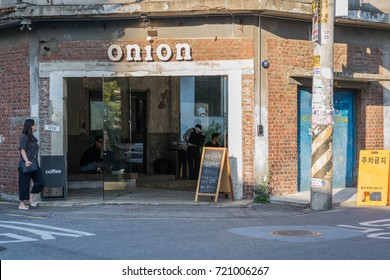 Neighborhood Cafe-a front shot of the exterior of the popular Onion Cafe with one pedestrian, in the Seongdong-gu neighborhood, Seoul, South Korea, on September 14, 2017