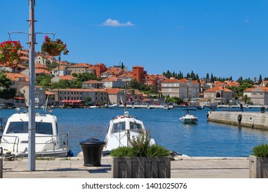 Gruž, a neighborhood in Dubrovnik, Croatia, Adriatic sea. Harbor and bay. Harbor boats. Port, harbor, ferry terminal, cruise port. Yacht Club. A harbor with white boats and yachts. Cruise ships