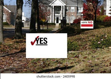 Neighborhood with election signs. These are yes and no that have been cleaned up for your own text. Shows opposition.