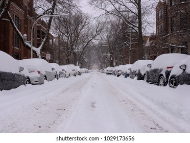 A neighborhood street in Chicago is covered with snow after a blizzard.
