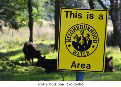 Neighborhood watch sign in cow paddock, Scotland