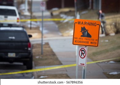 Neighborhood watch sign with crime scene tape.
