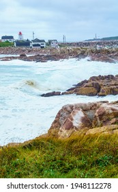 The Neils Harbour village and lighthouse on a stormy day, in Cape Breton island, Nova Scotia, Canada