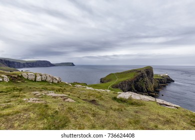 The Neist point lighthouse with coastline on the Isle of Skye in Scotland.