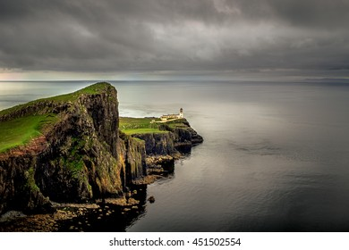 Neist point lighthouse, Isle of Skye, Scotland with dramatic and dark clouds during overcast day