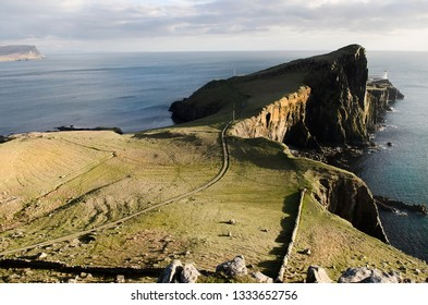 Neist Point on the Isle of Skye, scotland with the infamous lighthouse jutting out into the Atlantic Ocean