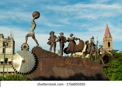 Neiva, Huila, Colombia. May 2019: Sculptures in the civic square Los Libertadores with trees and blue sky.