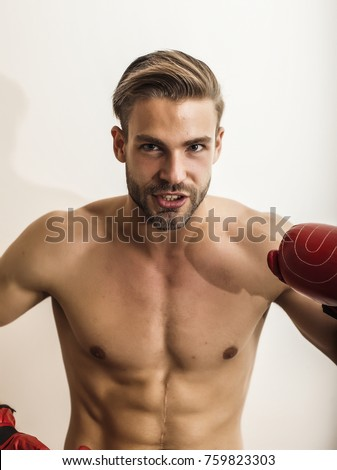 Neked Sexyal Man In Red Gloves Posing At White Background And Smiling
