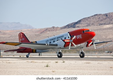 NELLIS AFB, LAS VEGAS, NV - NOVEMBER 14: US Forest Service Douglas-DC3TP lands after performing at Aviation Nation 2009 on November 14, 2009 in Nellis AFB, Las Vegas, NV