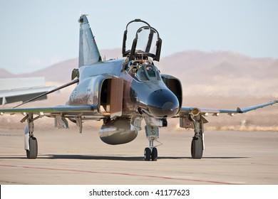 NELLIS AFB, LAS VEGAS, NV - NOVEMBER 14: McDonnel-Douglas F-4 Phantom Cold War-era fighter jet aircraft taxiing after performing at Aviation Nation 2009, November 14, 2009, Nellis AFB, Las Vegas, NV