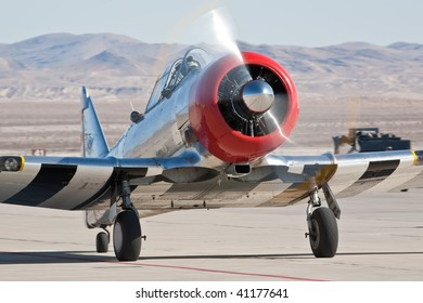 NELLIS AFB, LAS VEGAS, NV - NOVEMBER 14: North American SNJ-5 Texan WWII Trainer taxiing after performing at Aviation Nation 2009 on November 14, 2009 in Nellis AFB, Las Vegas, NV