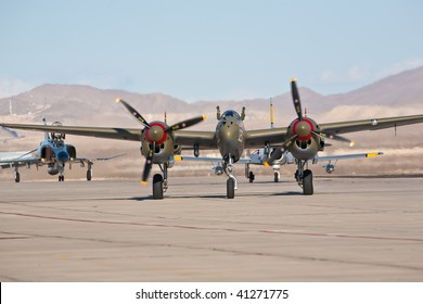 NELLIS AFB, LAS VEGAS, NV - NOVEMBER 14: Vintage Lockheed P-38 Lightning WWII-era fighter aircraft taxiing after performing at Aviation Nation 2009 on November 14, 2009 in Nellis AFB, Las Vegas, NV.