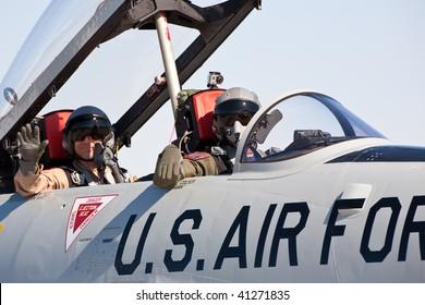NELLIS AFB, LAS VEGAS, NV - NOVEMBER 14: T-33 Shooting Star pilots greet spectators at Aviation Nation 2009 on November 14, 2009 in Nellis AFB, Las Vegas, NV.