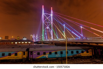 Nelson Mandela Bridge at night. The 284 meter long Nelson Mandela Bridge connecting Newtown, which was opened by Nelson Mandela himself. Seen over the 40 railway lines it helps traverse.