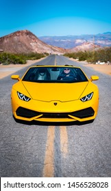 Nelson, Nevada / United States - June 02, 2019: A tourist enjoys a yellow Lamborghini near an old ghost town.