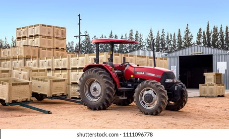 Nelspruit, South Africa, May 31 - 2018: Tractor with fruit crates standing in front of a pack-house.