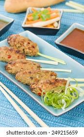 Nem Nuong Xa - Vietnamese minced pork sausages on lemongrass skewers served do chua, nouc cham and chili sauce.