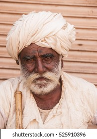 NEMAWAR, MADHYA PRADESH, INDIA - 19 OCTOBER 2011 : unidentified old man  sitting in front of Siddheshwar Ancient Temple, Nemawar, Dewas District, Madhya Pradesh, India.