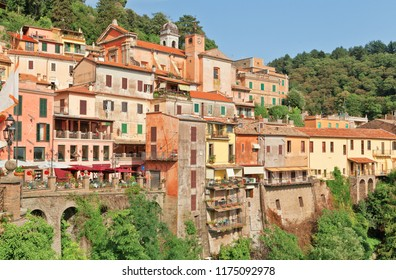 Nemi village streets with colorful homes and tourists in italy.