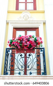 Neo classic facade with terrace and beautiful flowers.