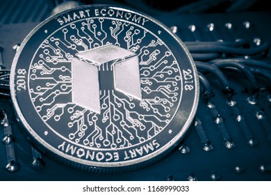 Neo cryptocurrency coin on grey shiny background.