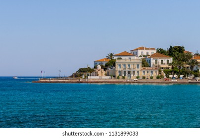 Neoclassic houses by the sea, in Spetses island, in Saronic gulf, Greece.