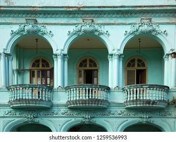 Neoclassical balcony with column in mint green in Old Havana in Cuba